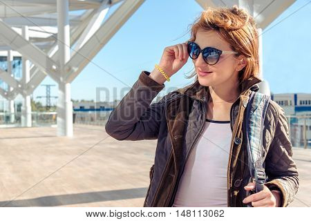 Redhead girl in jacket Sunny day beauty emotion laughter