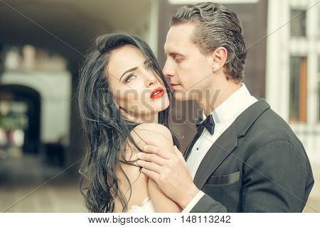 Handsome Groom Holds Beautiful Bride