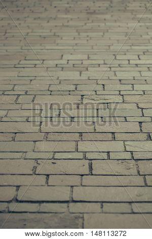 Rectangular brick paving stone road street in urban environment on grey background