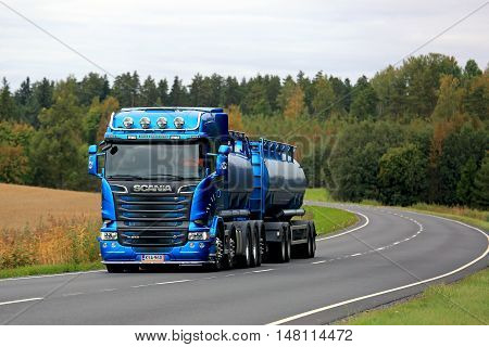 SALO, FINLAND - SEPTEMBER 17, 2016: Metallic blue Scania R580 tank truck moves along rural road in early autumn in South of Finland.