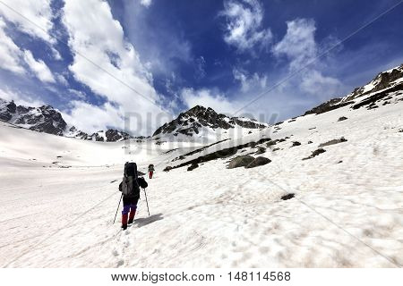 Two hikers in snow plateau. Turkey Kachkar Mountains highest part of Pontic Mountains. Wide angle view.