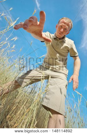 Man find some in grass. Funny scene.