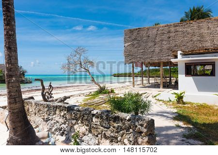 beaufiful landscape with blue sea and sky on the background and a house on the beach in Zanzibar, Africa