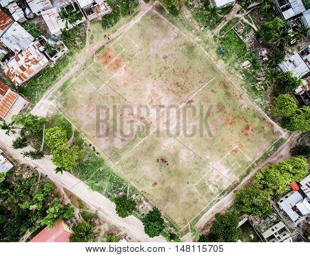 primitive football field in poor Zanzibar village, top view, aerial photo