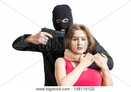 Hostage of terrorist or burglar threatening with gun. Isolated on white background.