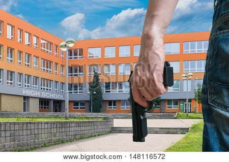 Gun Control Concept. Young Armed Man Holds Pistol In Hand In Pub
