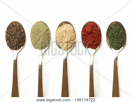 Spices in spoons. Tasty spices. Spices for recipes of dishes.