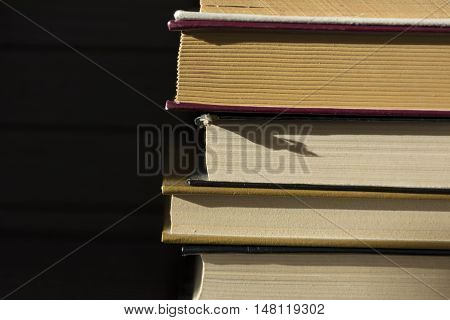 few books hardcover is upon each other exactly