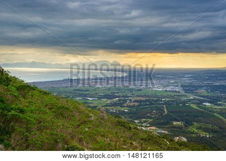 Aerial view of Cape Town from Sir Lowry's Pass South Africa. Winter season cloudy and dramatic sky.