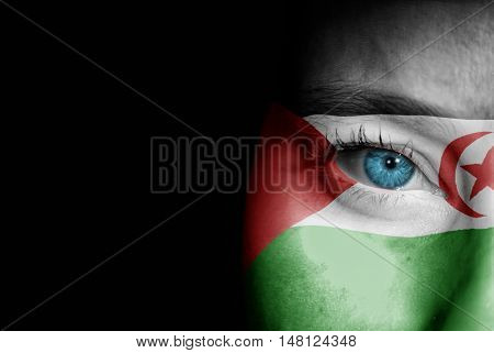 A young female with the flag of Western Sahara painted on her face on her way to a sporting event to show her support.