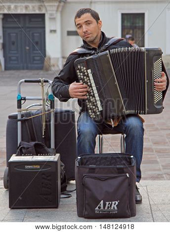 Krakow, Poland - October 29, 2015: man is playing accordion outdoor in Krakow, Poland
