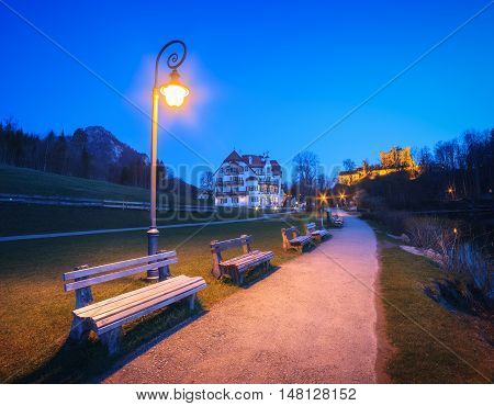Beautiful Benches With Street Lamp At Night In Germany