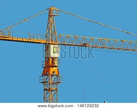 Big Yellow Crane Tower On Blue Sky
