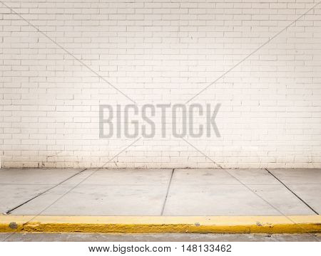 room with white bricks wall and grey cement floor