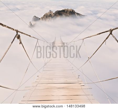 rope bridge with wood planks in the sky