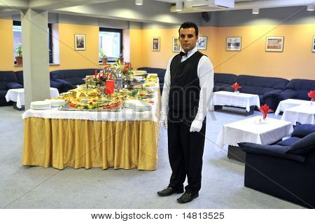 Young waiter in reataurant