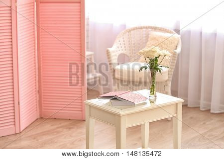 Light room interior with pink folding screen