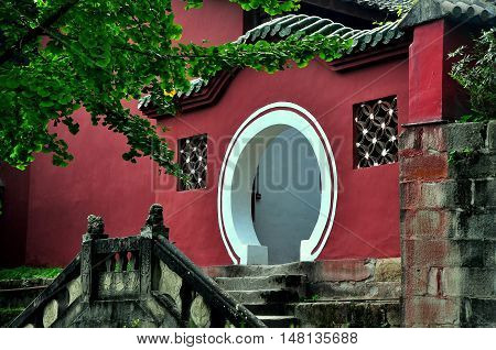 Langzhong Ancient City China - October 22 2013: A classic Chinese moongate leads to the tomb of legendary ruler Zhangfei at the historic Huanzhou Temple *
