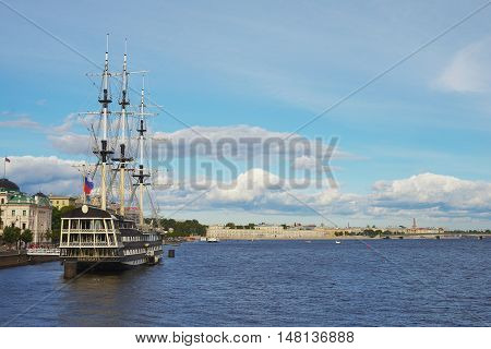SAINT-PETERSBURG RUSSIA SEPTEMBER - 2016 Panorama of St. Petersburg and the waters of the Neva River with the frigate Grace in the foreground.