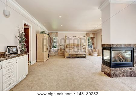 Large Master Creamy Tones Bedroom In Luxury Home.