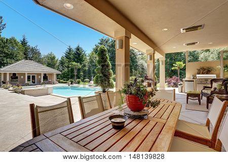 Relaxing Outdoor Seating Arrangement Overlooking Swimming Pool.