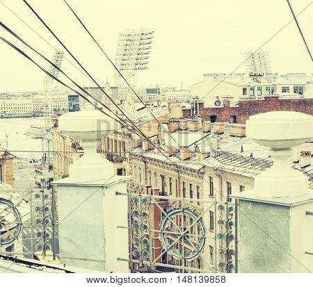 toned vintage card view roof top city scape St.Petersburg Russia close up