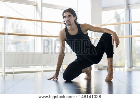 Young Male Ballet Dancer Posing, Man Practicing Stretch In Dance Studio