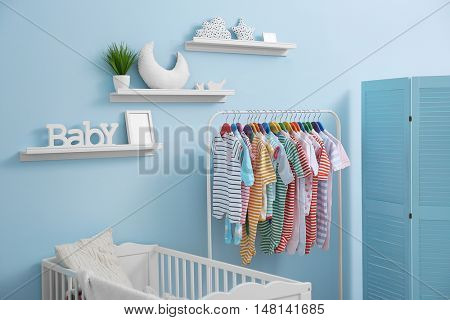 Shelves with hanger in modern baby room