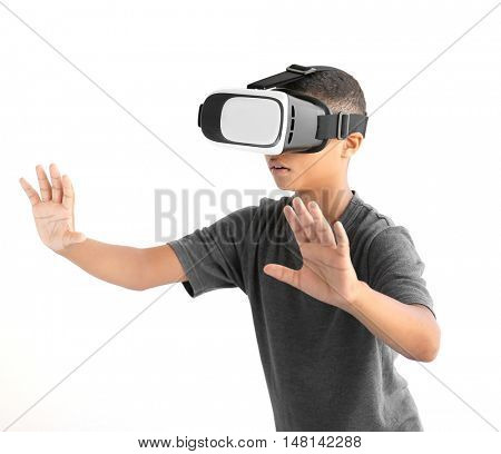 African-American boy wearing virtual reality glasses on white background