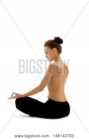 Topless woman meditating, isolated on white backdrop