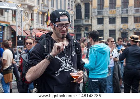 BELGIUM, BRUSSELS - SEPTEMBER 07, 2014: Belgian Beer Weekend 2014. The most famous beer festival in Belgium. Man at the festiwal.