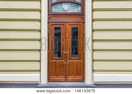 Wooden doors of the old stone house.