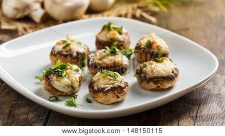 Stuffed mushrooms with parmesan crust and fresh herbs.