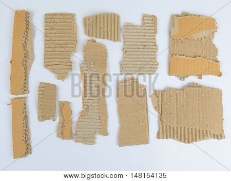 Pieces of torn brown corrugated cardboard  on white background