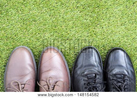 black and brown leather shoes over green grass field keep walking concept