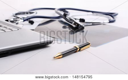 stethoscope with the handle and papers  at the workplace of Dr.