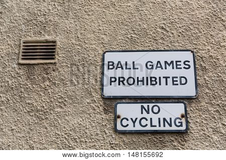Prohibition Signs At A House Wall