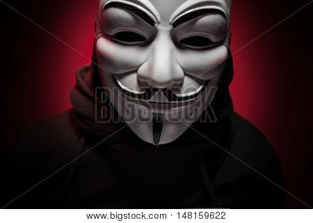 Saint-Petersburg, Russia - September 16, 2016: Photo of man wearing Vendetta mask, studio shot