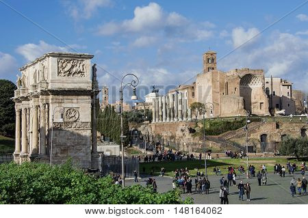ROME, ITALY - JANUARY 10: Archeological area with Arch of Constantine Temple of Venus and tourist JANUARY 10, 2016 in Rome, Italy