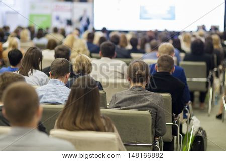 Business Concepts. People At the Conference Listening to Speaker On Stage in Front of Audience. Horizontal Image Orientation
