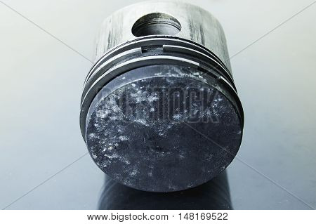 closeup of piston caused by burning through its use.