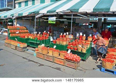 MONTREAL QUEBEC CANADA 09 16 2016: People buy groceries at Jean-Talon Market is a farmer's market in Montreal. Located in the Little Italy district, the market is bordered by Jean-Talon Street
