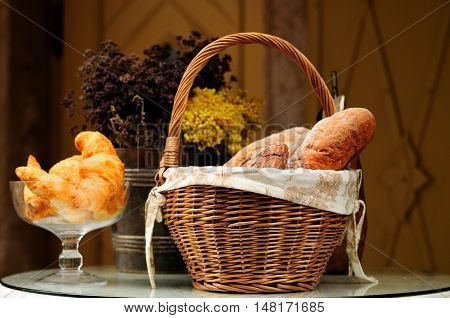 Composition With Bread And Rolls In Wicker Basket
