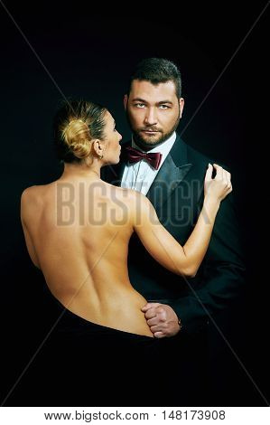 Portrait of passionate couple on a dark background , girl Topless