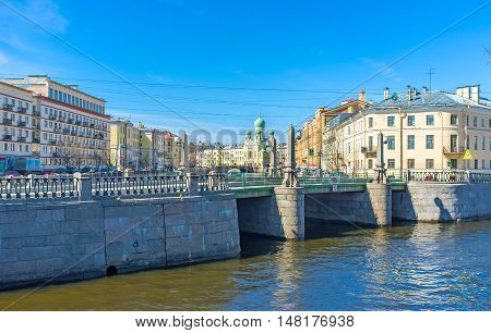 The Krukov Bridge with the Estonian Orthodox Church of Martyr Isidore Yuriev on the background St Petersburg Russia.