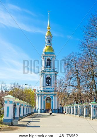 ST PETERSBURG RUSSIA - APRIL 25 2015: The slender bell tower of the Maritime Cathedral of St Nicholas (Sailors' Cathedral) with the tall golden spire on April 25 in St Petersburg.