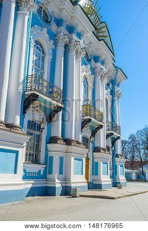 The bright blue facade with white columns of the St Nicholas Naval Cathedral in St Petersburg Russia.