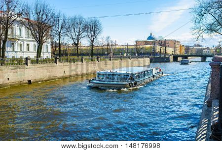 The pleasure boats are the famous tourist attraction in city Krukov Canal St Petersburg Russia.
