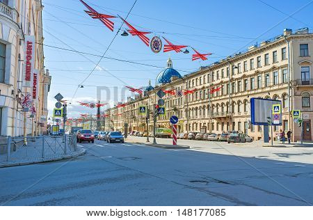ST PETERSBURG RUSSIA - APRIL 25 2015: The wide Izmailovsky Prospekt with the blue domes of Trinity Cathedral on background decorated to the Victory Day on April 25 in St Petersburg.