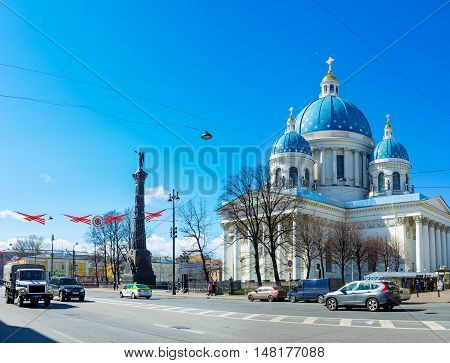 ST PETERSBURG RUSSIA - APRIL 25 2015: The facade of Trinity Cathedral in Izmailovsky Prospekt with the Russo-Turkish War Glory Column made of replicas of Turkish cannons on April 25 in St Petersburg.
